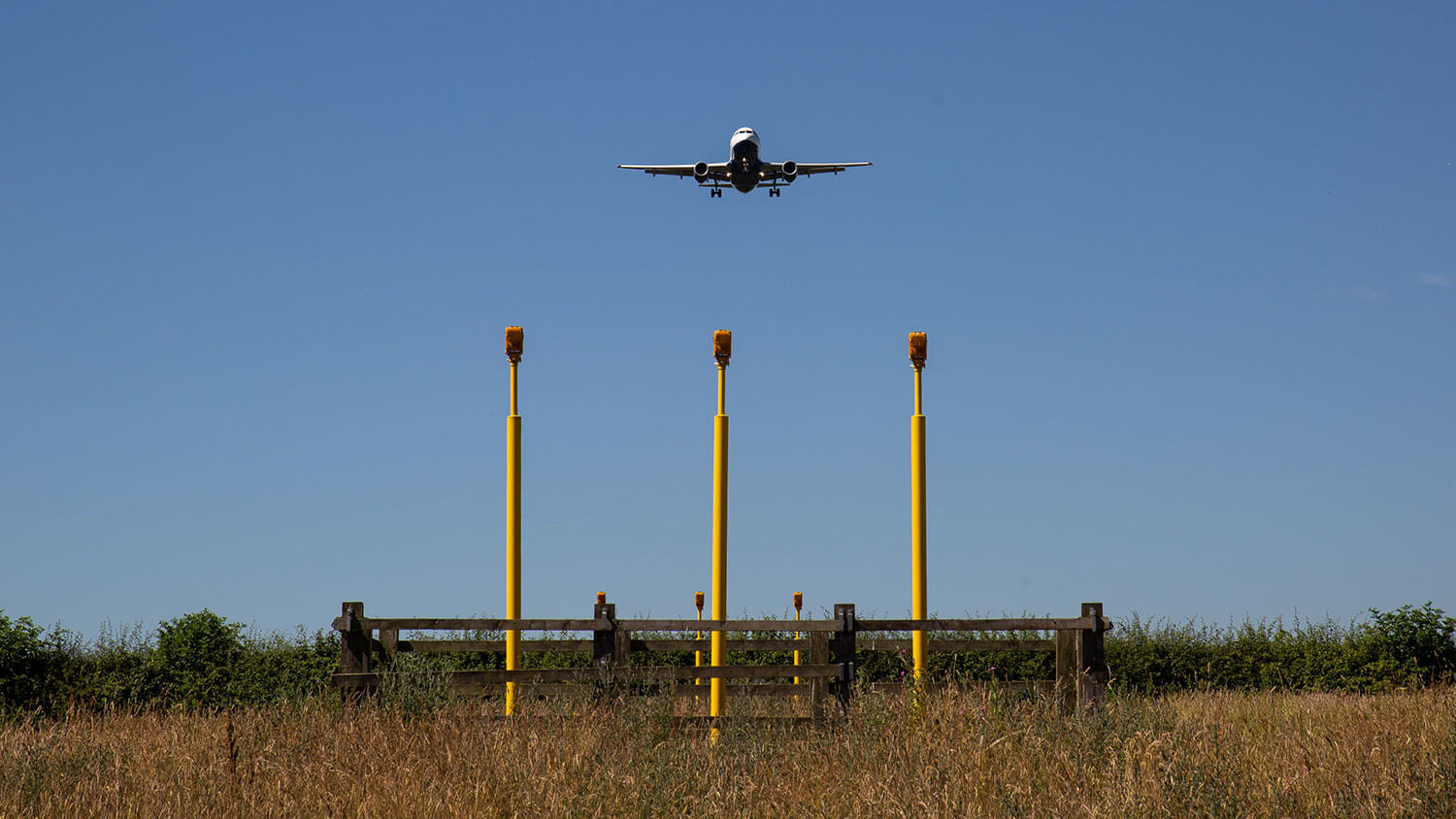 Air freight on final approach over landing lights