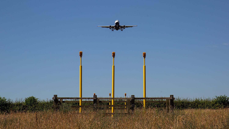 Air freight on final approach over landing lights